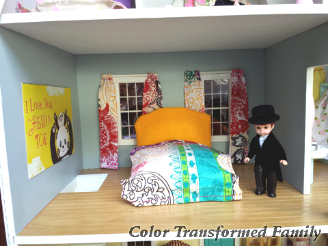 Use scrap card board and batting to make your own bed for dollhouse.